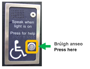 Close-up image of front door buzzer. This picture shows the buzzer at the front door of An Bord Pleanála's office. There is a button located half way down the panel on the right hand side. It is located under the Braille text and has a blue light behind it. In the image, the button to operate the buzzer has a yellow box around it and a green arrow pointing to it from the right-hand side.When the buzzer is pressed, a security guard will unlock the door for you or you can ask for assistance.